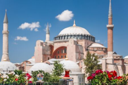 Traditional cup of tea with view at Hagia Sophia in the backgound at Istanbul Turkey.