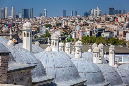 Suleymaniye Bath roofs with city panorama at Istanbul Turkey.