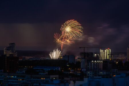 Fireworks light up the sky over night city. During this event person was killed by exploding fireworks in Minsk, Belarus. 版權商用圖片