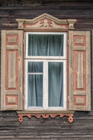 Old platband on the window in Ozertso near Minsk, Belarus.