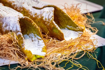 Sweet homemade cannoli stuffed with ricotta cheese cream and pistachial Sicilian dessert at market in Catania Sicily, Italy. Stok Fotoğraf