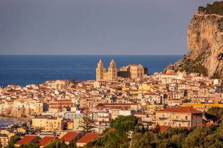 Attractive evening cityscape of Cefalu town. Amazing sunset on Mediterranean sea at Catania Sicily, Italy. Stock Photo - 130114547