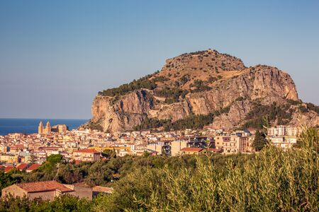 Attractive evening cityscape of Cefalu town. Amazing sunset on Mediterranean sea at Catania Sicily, Italy.