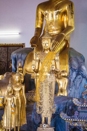 Golden Buddha statues in Wat Pho temple in Bangkok. The temple is located on Rattanakosin Island next to the Grand Palace. Imagens