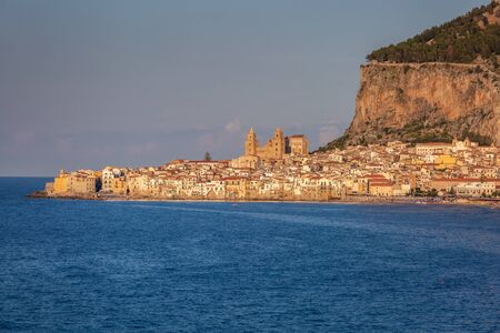 Attractive evening cityscape of Cefalu town. Amazing sunset on Mediterranean sea at Catania Sicily, Italy. Stock Photo - 130113755