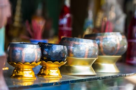 Made bowls on stand. Handwork in the village of monks in Thailand.