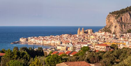 Panoramic evening cityscape of Cefalu town. Amazing sunset on Mediterranean sea at Catania Sicily, Italy. Stock Photo