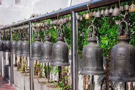 Many old bells in the temple of Wat Saket and the Golden Mount in Bangkok, the capital of Thailand.