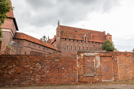 Malbork, Poland - June 23 2018: Famous and the largest  castle in the world measured by land area on a cloudy day,  located near the town of Malbork, Poland.