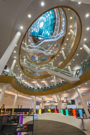 Modern shopping mall with stylish interior and bright light indoors