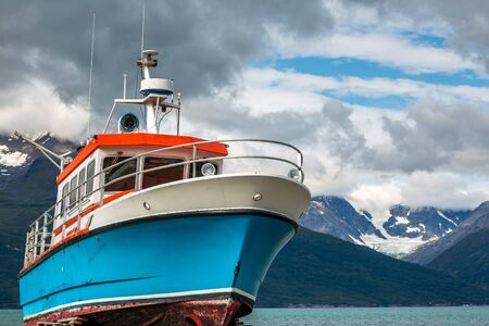 Boat with a view upon snowy mountains at northern Norway near the town of Skibotn.