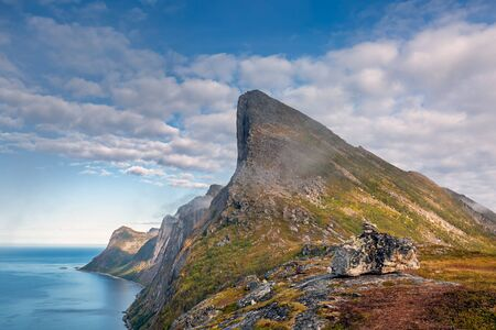 Aerial view on mountains ridge over clouds adventure journey traveling outdoor in Norway active vacations sunset Segla mountain, Senja.