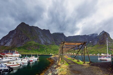 Cod dryer at Reine, fishing village is located on the island of Moskenesoya in the Lofoten archipelago, above the Arctic Circle, Norway.