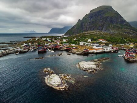 """Aerial view at red houses at Ã… (meaning """"stream"""") is a village in Moskenes Municipality in Nordland county, Norway. This is last town on Lofoten islands by highway called King Olav's Road."""