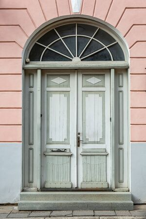 Wooden beautifully colored and decorated old door in Tallinn, Estonia.
