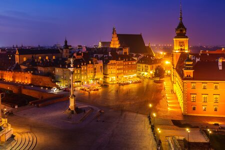 Aerial view of the old city in Warsaw. Royal Castle, ancient townhouses and Sigismund's Column in Old town in Warsaw, Poland. Evening view, long exposure.