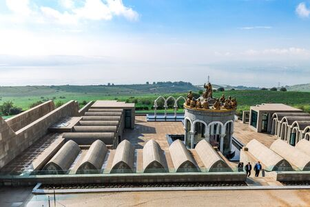 Tiberias, Israel - April 02 2019: View of the Domus Galilaeae on the Mount of Beatitudes near the Sea of Galilee with the statues of Jesus and Twelve Apostles in Galilee, Israel