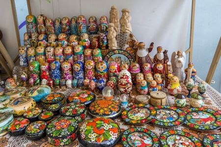 Kiev, Ukraine - July 17 2019: A collection of different Matryoshka - wooden dolls. Vintage handmade toys that are sold as souvenirs in Russia and Ukraine.