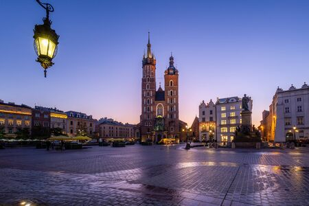 Market Square at sunrise in old city center at Krakow at morning time, main square, famous cathedral at sunrise in Krakow, Poland. Krakow, Poland - October 17 2019.