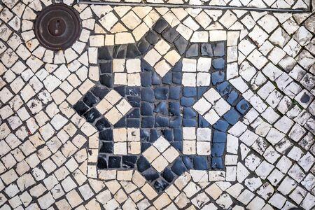 Black and Beige vintage square mosaic pattern cobblestone pavement at Macau, China.