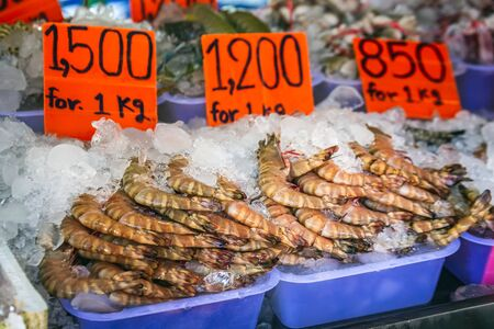 Fresh seafood fishing market in Southeast Asia. Live langust and spiny shrimps at a seafood market in Sea Gypsies Village, Phuket Island, Thailand. Yummy and delicious seafood just caught from ocean.