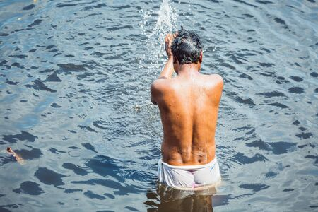 Indian man bathing in the river at Vrindavan, India. Stok Fotoğraf