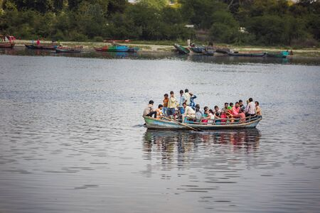 Vrindavan, India - March 12 2017: Indian people in the boat at Vrindavan, India.