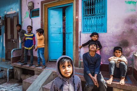 Vrindavan, India - March 12 2017: Indian children on the streets celebrating Holi festival in Vrindavan, India.