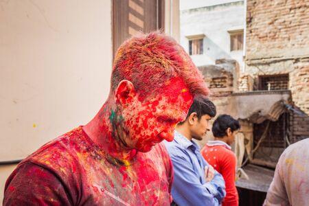 Vrindavan, India - March 12 2017: Tourist covered in different colours celebrating Holi festival in Vrindavan, India.