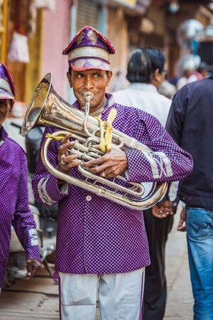 Vrindavan, India - March 12 2017: Indian people plays tuba at Holi festival in Vrindavan, India. Editöryel