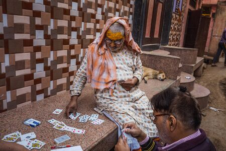 Agra, India - March 12 2017:  Indian man plaing cards at Holi festival in Vrindavan, India.