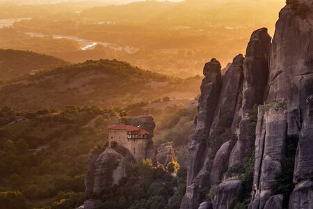 Monastery Meteora Greece. Stunning summer panoramic landscape. View at mountains and green forest against epic blue sky  clouds.   list object. Standard-Bild