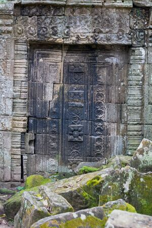 Antient door in temple ruins at Angkor Wat, Siem Reap, Cambodia.