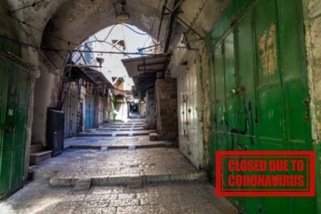 The empty street with closed shops in the Old City of Jerusalem. Following the coronavirus outbreak, the Israeli Government has decided for a massive curfew, leaving the Old Town totally deserted.