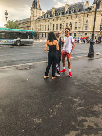 Street style of local pople. Paris, France - July 27 2018.