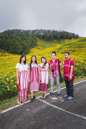Locals wearing traditional clothes come to see sunflowers bloom at Doi Inthanon park. Chiang Mai, Thailand - November 11 2017.