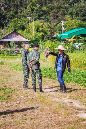 Government representative helps local farmers to develop agricultural farms. Chiang Mai, Thailand - November 12 2017.