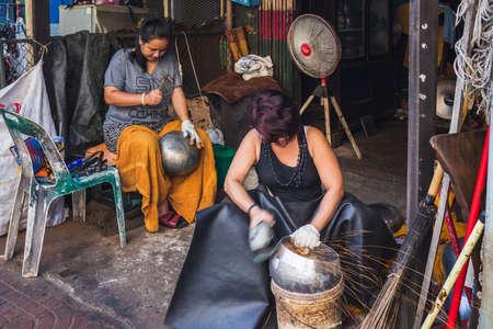 Hand made creation of iron bowl at the Monk Bowl Village (Baan Bat), Thailand. Bangkok, Thailand - December 09 2017.