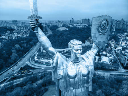 Drone view. The Motherland Monument is a monumental statue in Kiev, the capital of Ukraine. The sculpture is a part of the Museum of The History of Ukraine. Blue toning. KIEV, UKRAINE - January 04, 2020. 新闻类图片