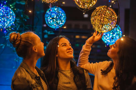 Young girls enjoy New Year decorations. Auckland, New Zealand - December 16 2017. Editorial