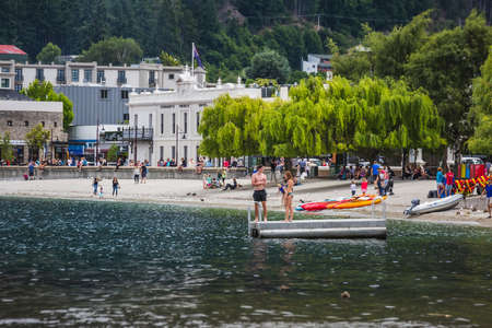 People at the beach of Queenstown New Zealand, South Island. Queenstown, New Zealand - December 17 2017. Editorial