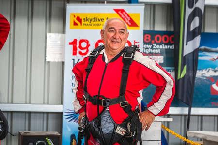 Elderly skydiver at the skydive center. Franz Josef Glacier, New Zealand - January 02 2018.