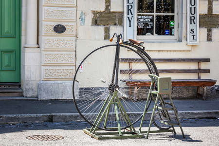 Old bicycle with huge wheel at the local market. Oamaru, New Zealand - January 07 2018.