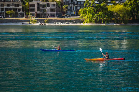 People exercise on kayaks in Queenstown New Zealand, South Island. Queenstown, New Zealand - December 18 2017.