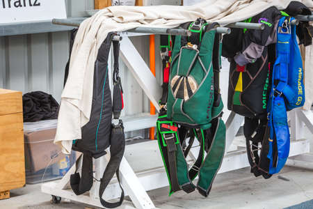 Parachutes on the rack at the skydive center. Franz Josef Glacier, New Zealand - January 02 2018.