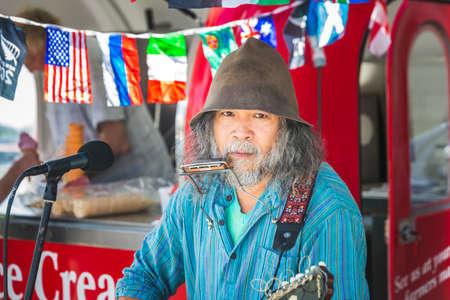 Street musician at the local market. Oamaru, New Zealand - January 07 2018. Editorial