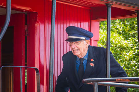 Old train driver at the local market. Oamaru, New Zealand - January 07 2018.
