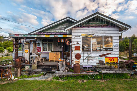 House and fence decorated with old car plates at Ross, New Zealand. Ross, New Zealand - January 01 2018. Editorial