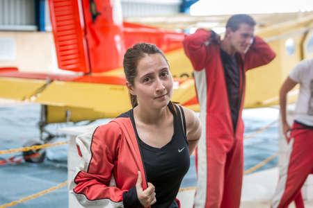 Scared girl prepares to skydive. Franz Josef Glacier, New Zealand - January 02 2018. Editorial