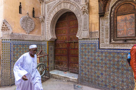 Entrance mosaic gate to the largest medina in Fes, Morocco, Africa. Fes, Morocco - April 10 2016. Foto de archivo - 156207681